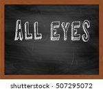Small photo of ALL EYES hand writing chalk text on black chalkboard