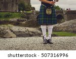 Bagpiper's Legs At Traditional...