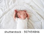 newborn baby boy lying on bed ... | Shutterstock . vector #507454846