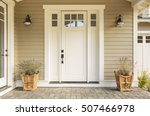 white front door with small...