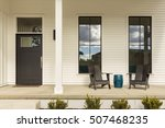 Porch With Adirondack Chairs...