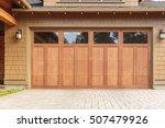 Closed brown garage door with...
