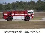 Small photo of US Navy fire truck at Pensacola Naval Air Station Florida USA October 2016