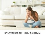 young woman using  laptop | Shutterstock . vector #507535822