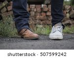 two feet with different shoes... | Shutterstock . vector #507599242