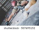 little boy climbing a rock wall ... | Shutterstock . vector #507695152