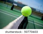 a tennis ball clips the top of... | Shutterstock . vector #50770603