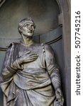 Small photo of Closeup of the Amerigo Vespucci statue in Florence, Italy