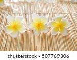 Three Frangipani And Bamboo Mat