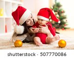 mother and baby in santa red... | Shutterstock . vector #507770086