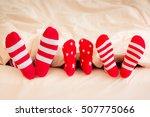 Family In Christmas Socks Lyin...