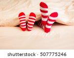 family in christmas socks lying ...   Shutterstock . vector #507775246