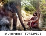 asian man with his big elephant. | Shutterstock . vector #507829876