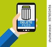 hand holding smartphone  delete ... | Shutterstock . vector #507853456