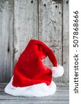santa claus hat on rustic wood... | Shutterstock . vector #507868666