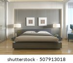 Stock photo modern one double bed front view with a niche at the head and two hanging lamps over bedside 507913018
