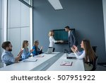 two colleagues handshaking... | Shutterstock . vector #507951922