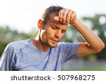 tired athlete wiping with hand... | Shutterstock . vector #507968275