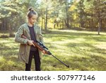 young girl shooting from the... | Shutterstock . vector #507977146