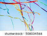 colored ribbons on blue sky
