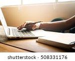 male hand using laptop on desk... | Shutterstock . vector #508331176