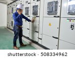 Small photo of Hanoi, Vietnam 06 August 2016: Hawee worker operating Main electric switchboard at site with phone, talkie. Blokset Schneider, fully type test, standard IEC switchboard