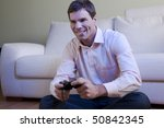 young man playing video games | Shutterstock . vector #50842345