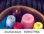 Colorful Spools Of Thread In A...