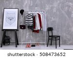 fashionable clothes hanging on... | Shutterstock . vector #508473652