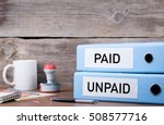 paid and unpaid. two binders on ... | Shutterstock . vector #508577716