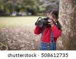 Little Girl Taking A Photo With ...