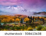 Storm clouds begin to  clear revealing fresh snow on East Beckwith Mountain along Kebler Pass outside of Crested Butte, Colorado during autumn - stock photo