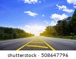 Road In Forest And Blue Sky O...