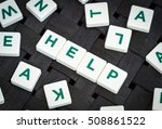"""word """"help"""" made from plastic... 