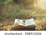 book of poetry outdoors with...