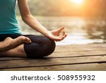 Stock photo close up hand woman do yoga outdoor woman exercising yoga at the nature background select focus 508955932