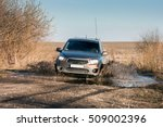 Small photo of Pick up car rides on the mud puddle