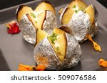 jacket potato with sour cream | Shutterstock . vector #509076586