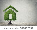 house shaped green tree as real ... | Shutterstock . vector #509082352
