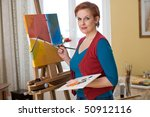 Female Artist Painting In Her...
