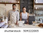 couple ready to serve behind... | Shutterstock . vector #509222005