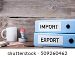 Small photo of Import and Export. Two binders on desk in the office. Business background