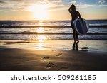 girl surfer in black diving...   Shutterstock . vector #509261185
