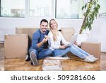 couple celebrating moving into... | Shutterstock . vector #509281606
