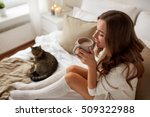 Stock photo morning leisure christmas winter and people concept happy young woman with cup of coffee or 509322988