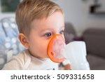 little boy taking inhalation... | Shutterstock . vector #509331658