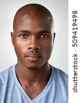 Stock photo portrait of real black african man with no expression id or passport photo full collection of 509419498