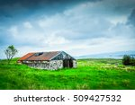 Abandoned Barn Under Storm...