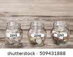 money in the glass on wood... | Shutterstock . vector #509431888