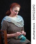 senior woman knitting sitting...   Shutterstock . vector #509522692